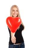 Mujer joven con el globo de la dimensión de una variable del corazón Imágenes de archivo libres de regalías