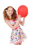 Mujer joven con el globo rojo aislado Imagenes de archivo