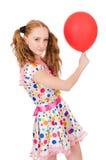Mujer joven con el globo rojo aislado Imágenes de archivo libres de regalías