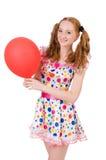 Mujer joven con el globo rojo aislado Foto de archivo libre de regalías