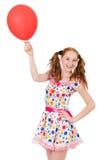 Mujer joven con el globo rojo aislado Fotografía de archivo libre de regalías