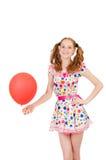 Mujer joven con el globo rojo aislado Fotografía de archivo