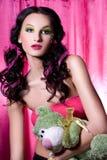 Mujer joven con el juguete de la felpa Fotografía de archivo libre de regalías