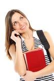 Mujer joven con el libro y el teléfono Fotografía de archivo