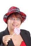 Mujer joven con el lollipop Foto de archivo