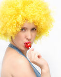 Mujer joven con el lollipop Fotografía de archivo