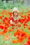 Mujer joven con el lollipop colorido Imágenes de archivo libres de regalías
