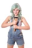 Mujer joven con el martillo Imagenes de archivo