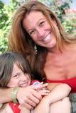 Mujer joven con el niño Fotografía de archivo