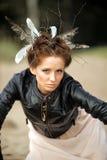 Mujer joven con el peinado creativo Foto de archivo libre de regalías