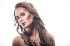 Mujer joven con el pelo azotado por el viento Imagenes de archivo