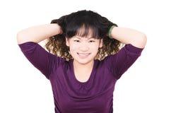 Mujer joven con el pelo rizado marrón Imágenes de archivo libres de regalías