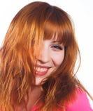 Mujer joven con el pelo rojo Imagen de archivo libre de regalías