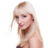 Mujer joven con el pelo rubio Imagenes de archivo