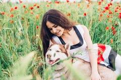 Mujer joven con el perro Imagenes de archivo