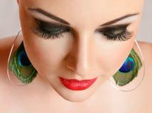 Mujer joven con el primer del maquillaje Fotografía de archivo libre de regalías