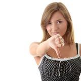 Mujer joven con el pulgar abajo Imagen de archivo