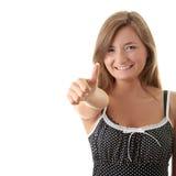Mujer joven con el pulgar para arriba Fotografía de archivo libre de regalías