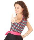 Mujer joven con el pulgar para arriba Foto de archivo