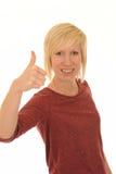 Mujer joven con el pulgar para arriba Foto de archivo libre de regalías