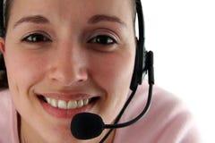 Mujer joven con el receptor de cabeza Foto de archivo libre de regalías