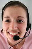 Mujer joven con el receptor de cabeza Fotografía de archivo libre de regalías