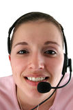 Mujer joven con el receptor de cabeza Fotos de archivo libres de regalías