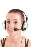 Mujer joven con el receptor de cabeza Imagenes de archivo