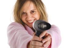 Mujer joven con el secador de pelo Fotos de archivo libres de regalías