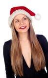 Mujer joven con el sombrero de la Navidad y los labios rojos Imágenes de archivo libres de regalías