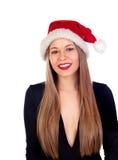 Mujer joven con el sombrero de la Navidad y los labios rojos Imagen de archivo