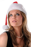Mujer joven con el sombrero de Santa foto de archivo libre de regalías