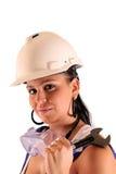 Mujer joven con el sombrero duro y las herramientas Foto de archivo libre de regalías