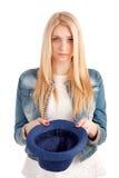 Mujer joven con el sombrero que pide dinero Foto de archivo libre de regalías