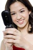 Mujer joven con el teléfono Foto de archivo libre de regalías