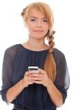 Mujer joven con el teléfono celular Foto de archivo