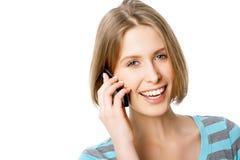 Mujer joven con el teléfono móvil Foto de archivo libre de regalías