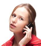 Mujer joven con el teléfono Fotografía de archivo
