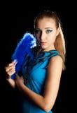 Mujer joven con el ventilador Imagen de archivo libre de regalías