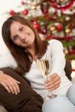Mujer joven con el vidrio de champán Imagenes de archivo
