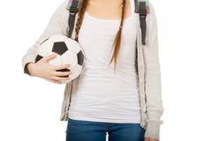 Mujer joven con la bola del pie Imagen de archivo libre de regalías