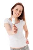 Mujer joven con la bombilla económica de energía Imágenes de archivo libres de regalías