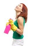 Mujer joven con la botella y la esponja del aerosol Imagen de archivo