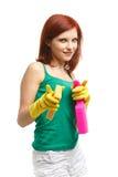 Mujer joven con la botella y la esponja del aerosol Imagenes de archivo