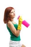 Mujer joven con la botella y la esponja del aerosol Foto de archivo libre de regalías