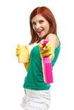 Mujer joven con la botella y la esponja del aerosol Imagen de archivo libre de regalías