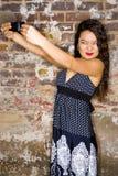 Mujer joven con la cámara Foto de archivo libre de regalías