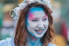 Mujer joven con la cara pintada Imagen de archivo libre de regalías