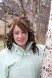 Mujer joven con la chaqueta encendido imágenes de archivo libres de regalías