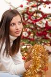 Mujer joven con la decoración de la Navidad Foto de archivo libre de regalías